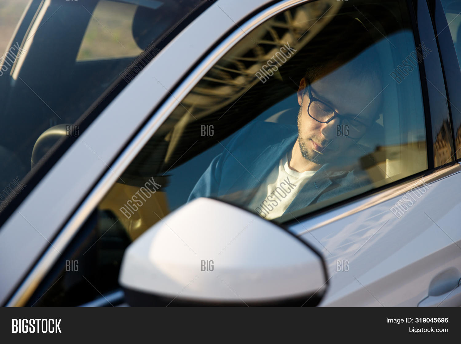 accident,adult,auto,automobile,business,businessman,car,caucasian,closed,drive,driver,exhausted,eye,face,fatigue,glasses,hand,hay,horizontal,male,man,relaxation,resting,road,sitting,sleep,sleepy,tired,transportation,vehicle,wheel,young