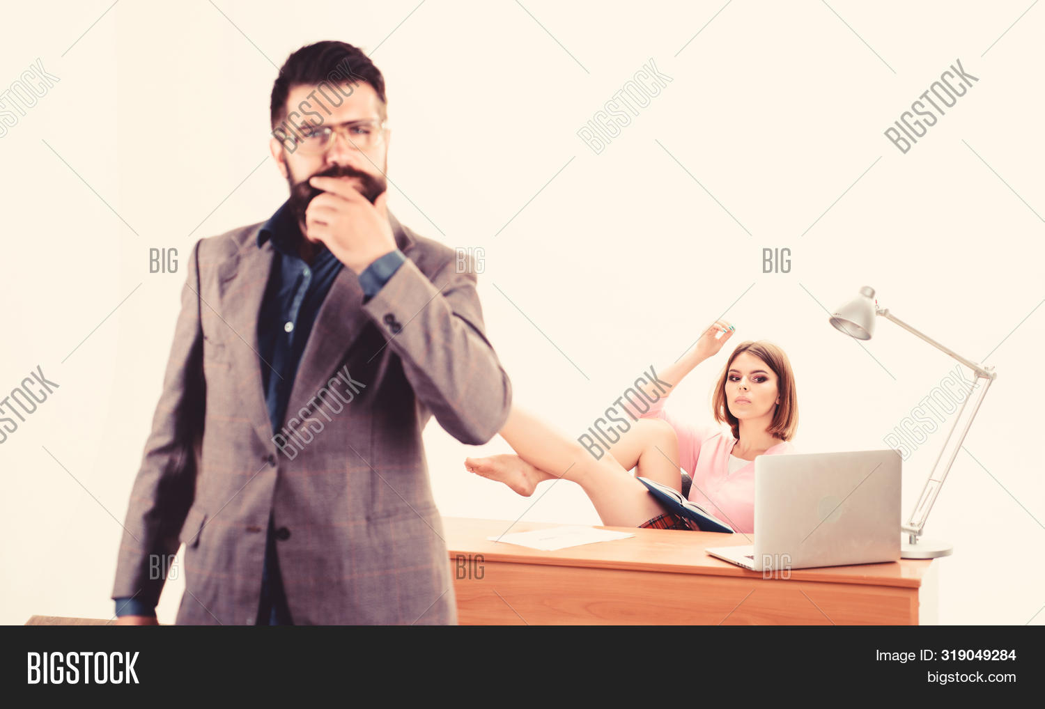 Skilful And Professional. Business And Professional Woman Working At Workplace With Bearded Man In F