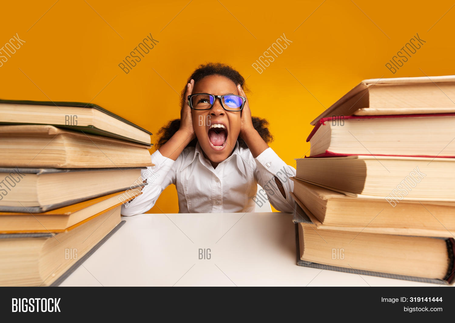School Overload. African American Schoolgirl Shouting Clutching Head Sitting Between Two Book Stacks