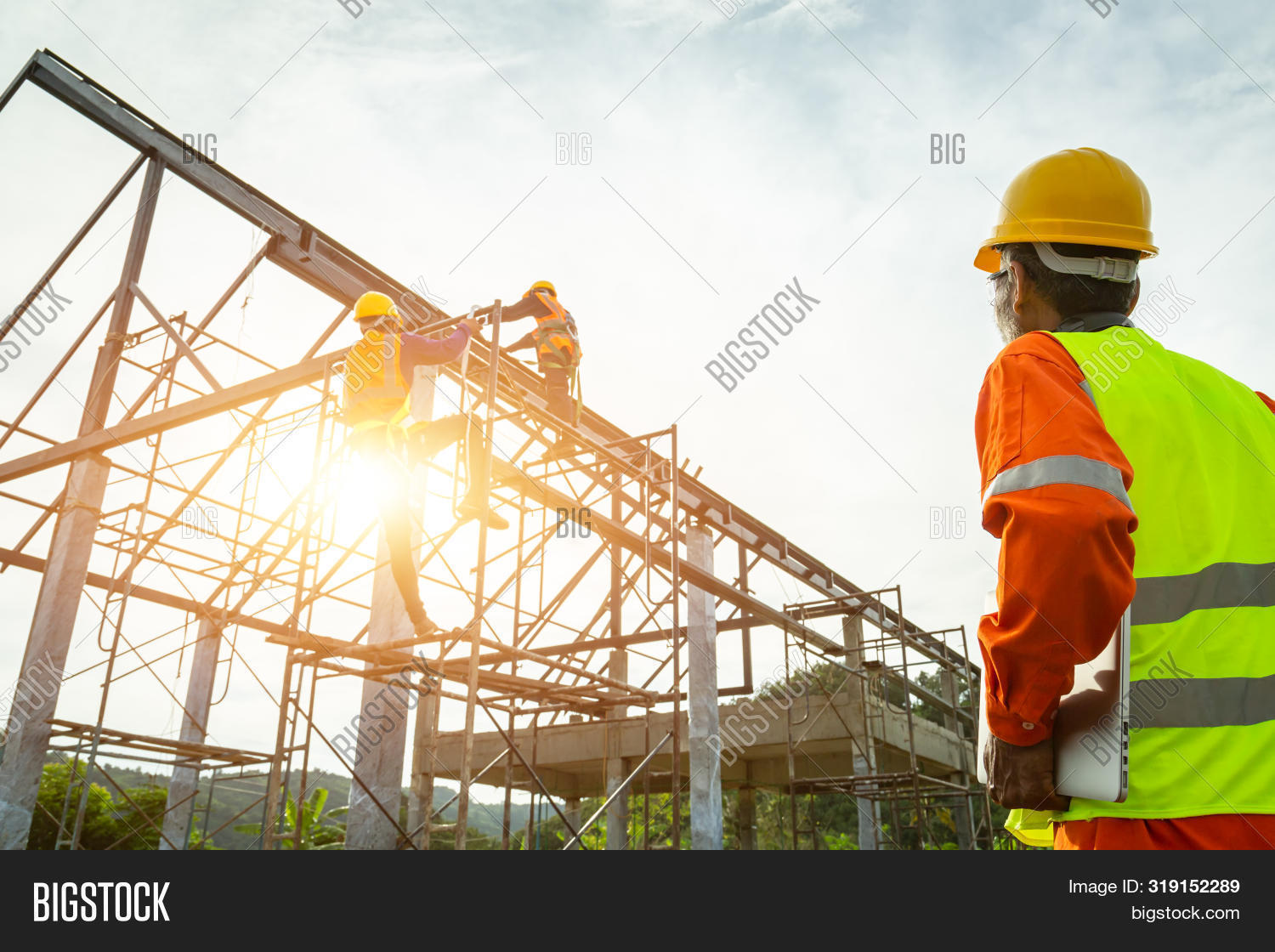 architect,architecture,background,builder,building,business,civil,cloth,computer,concrete,construct,construction,contractor,crane,design,drawing,engineer,engineering,equipment,factory,foreman,helmet,house,industrial,industry,inspection,inspector,jacket,job,male,man,manager,occupation,people,plan,profession,professional,project,safety,site,steel,structure,team,teamwork,technology,vest,work,worker,workplace