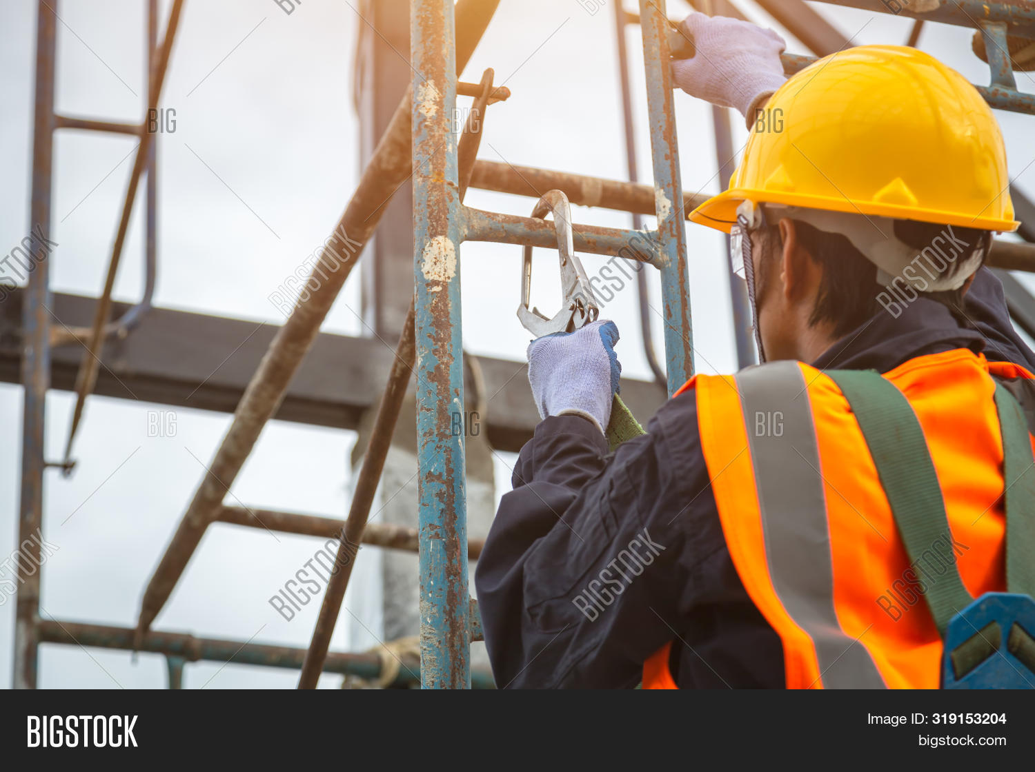 architecture,belt,builder,building,climb,concrete,construction,contractor,danger,dangerous,engineering,equipment,extreme,factory,harness,height,helmet,high,industrial,industry,instrument,job,labor,line,male,man,people,person,professional,protection,protective,risk,roof,roofer,safe,safety,scaffolding,security,site,stands,steel,structure,support,team,tool,training,uniform,work,worker