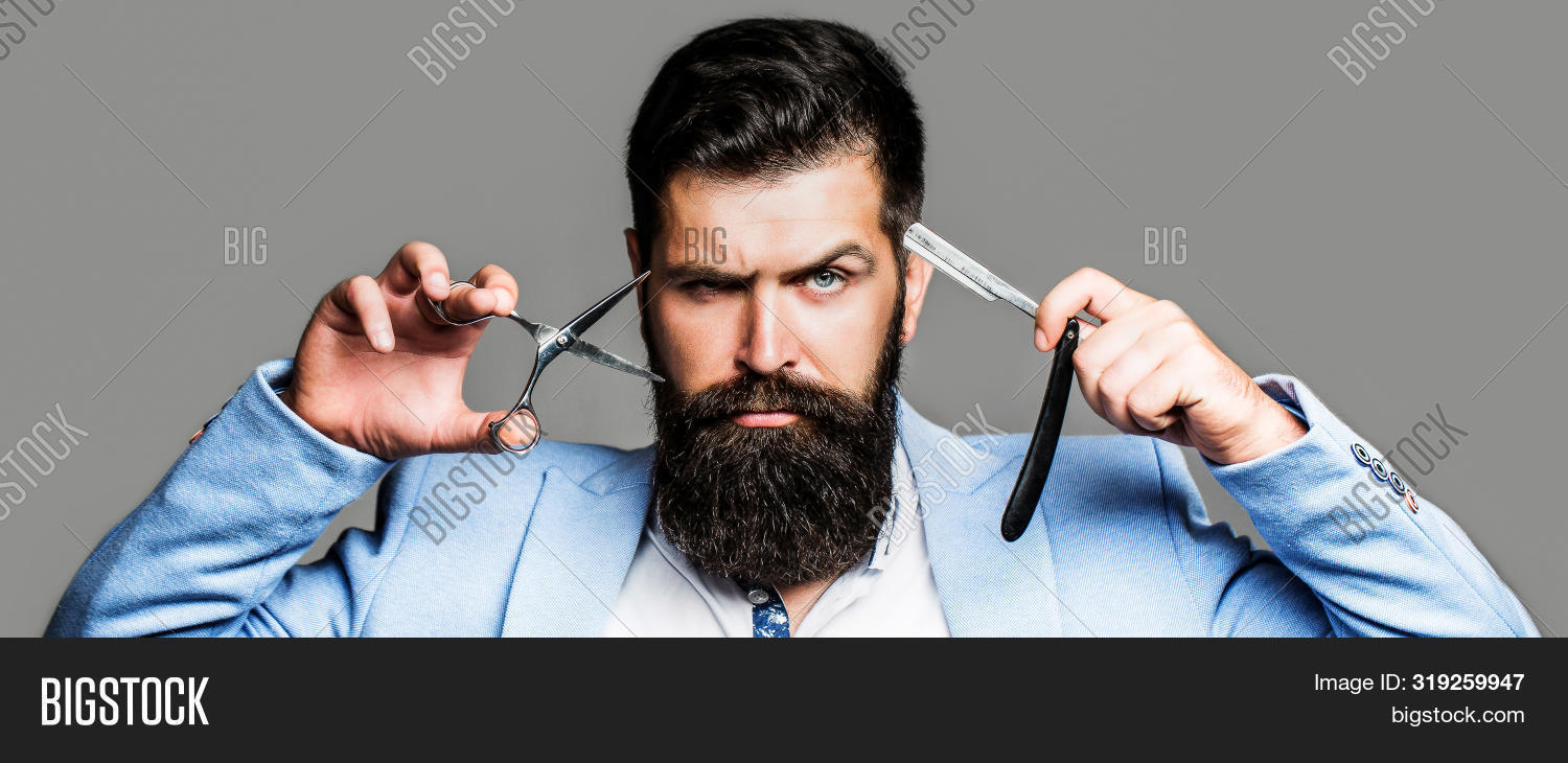 background,barber,barbershop,bear,beard,bearded,beauty,blade,blue,brutal,chair,closeup,coiffeur,cut,face,fashion,grooming,guy,hair,haircut,hairdresser,hairstyle,handsome,hipster,isolated,lifestyle,long,macho,male,man,men,modern,moustache,mustache,pole,portrait,razor,salon,scissor,serious,service,shaver,shaving,shop,straight,style,stylish,stylist,suit,vintage