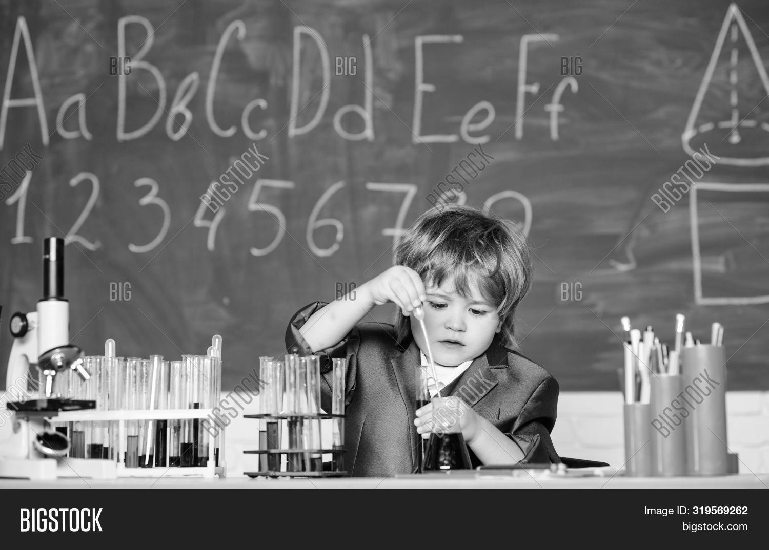 Happy Childhood. Boy Near Microscope And Test Tubes School Classroom. Knowledge Concept. Knowledge D