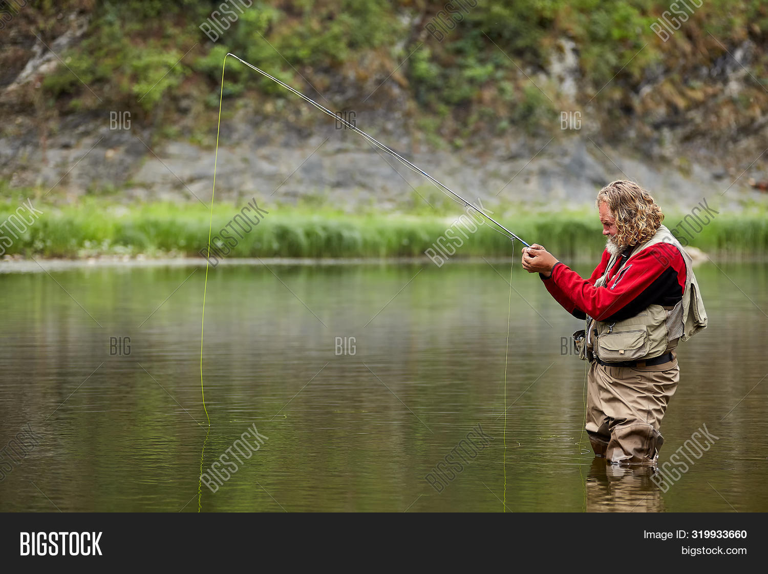 Fly Caster Angler Is Fishing In The Wild River Use Fly Casting Or Fly Fishing.