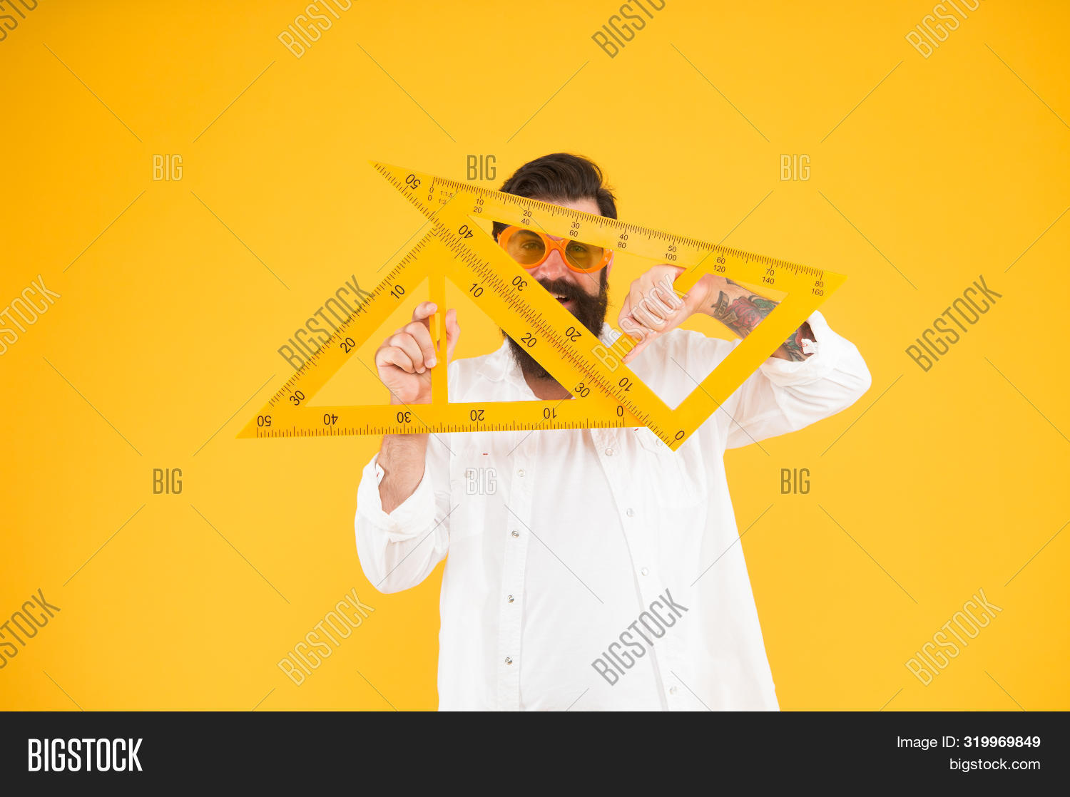 Too Smart For School. Smart Student Of Engineering Faculty Holding Triangles On Yellow Background. B