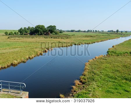 the village of ditzum at the river ems stock photo