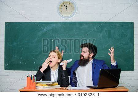 Concentrated On Exam. Teacher And Student On Exam. Business Couple Use Laptop And Documents. Back To