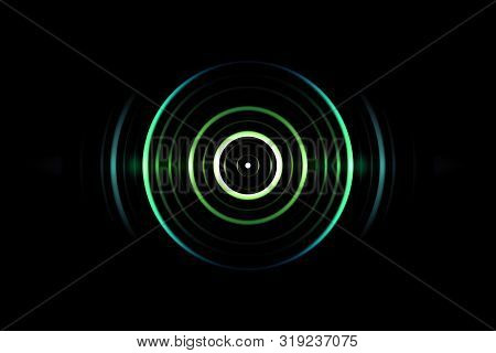 Abstract green circle effect with light blue rings sound waves oscillating on black background stock photo