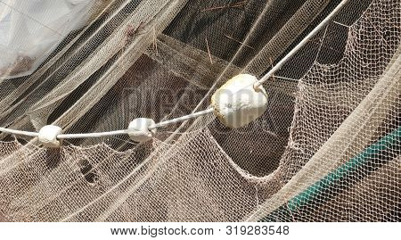Fishing net is hanging on the wall stock photo