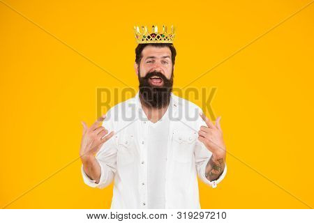 Superiority complex. Narcissistic person. Love yourself. Sense of self importance. Responsibility being king. Handsome bearded guy king. King crown. Egoist selfish man. Bearded man in white clothes. stock photo