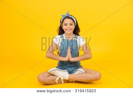 Yoga training. KId adorable girl sit meditate. Meditating practice. Life balance. Good vibes. Peaceful meditating. Learn meditating techniques. Stay positive and optimistic. Private space to relax. stock photo