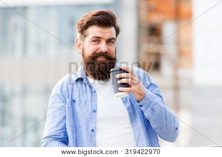 Making sip. Great ideas come from great coffee. Man drink take away coffee. Bearded man relax outdoors. Coffee break concept. Caffeine addicted. Morning coffee. Mature hipster enjoy hot beverage. stock photo