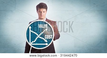 Young businessman touching chart icon depicting growth of value versus reduction of cost. Technology and business concept for cost effectiveness analysis, efficiency, productivity, pricing strategy. stock photo