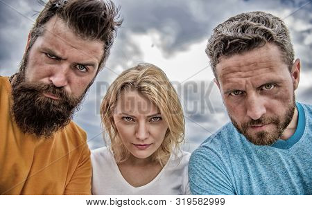 Suspicious look. They know what you did. Threesome suspiciously look down. Woman and men look confident sky background. Strength in unity. Stand up for their position. Group people suspect you stock photo