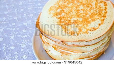 A stack of traditional Russian pancakes pancakes on a white background. Pancakes homemade Russian thin pancakes. Russian food, Russian cuisine stock photo