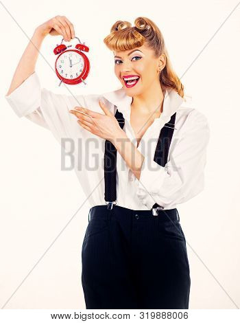 Girl with an alarm clock. Happy girl holds a vintage watch. Time concept. Happy adult. stock photo
