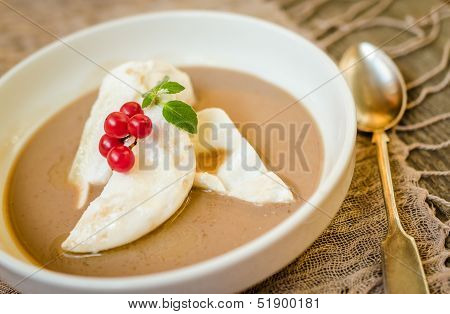 Floating Island Dessert with berries on the table stock photo