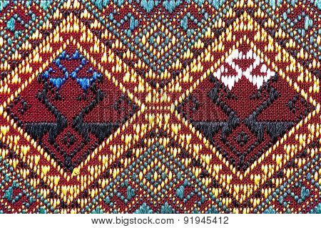 Colorful thai silk handcraft peruvian style rug surface close up More this motif & more textiles peruvian stripe beautiful background detail pattern farabic textile.old rag that does not use Recycle. stock photo