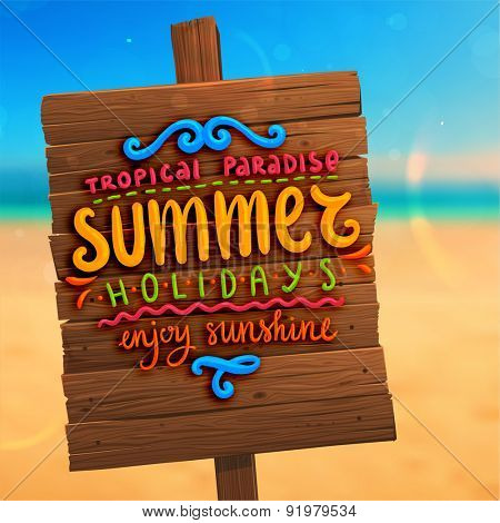 Wooden Plaque with Lettering. Blurred Background. Summer Beach. Sand and Ocean. Blue Sky with Clouds