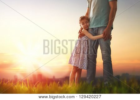Happy loving family. Father and his daughter child girl playing and hugging outdoors. Cute little gi