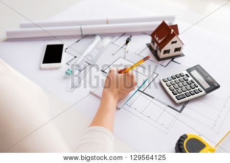 business, architecture, building, construction and people concept - close up of architect hand with