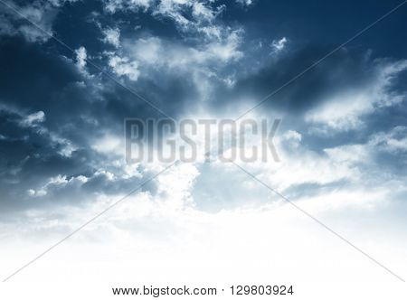 Cloudy sky background with white copy space, stormy dark dramatic sky, beautiful view at overcast weather day, moody nature scene