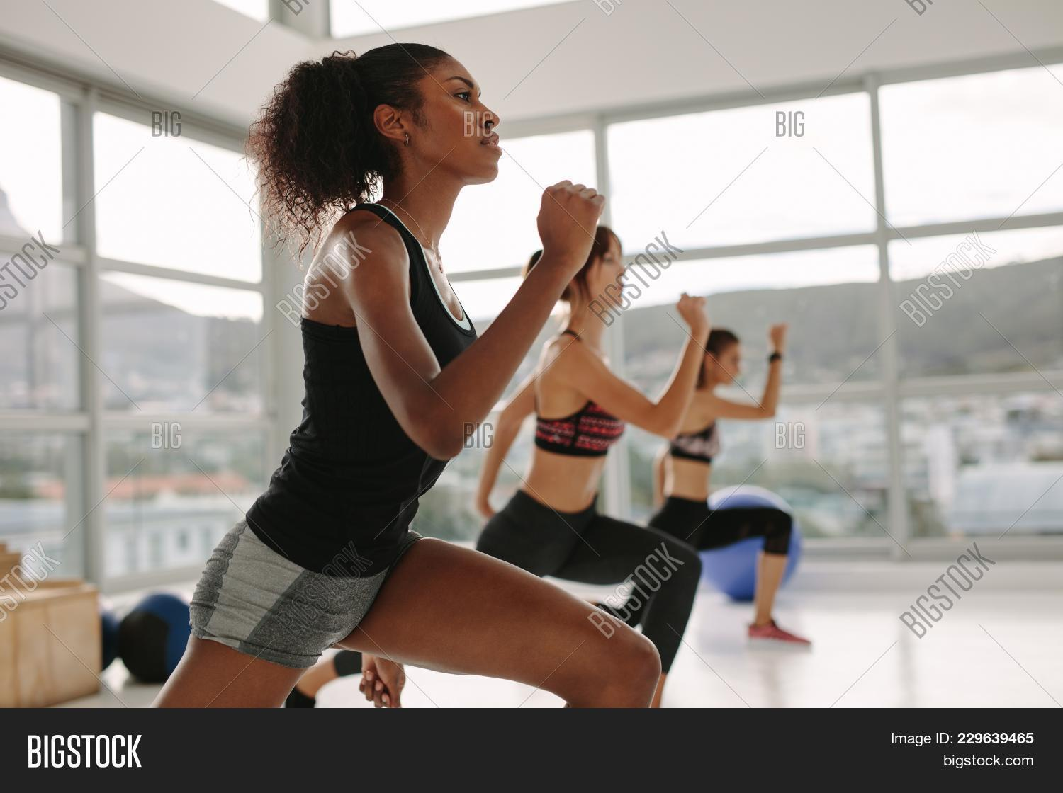 aerobics,body,class,exercise,exercising,female,fit,fitness,girls,group,gym,health,healthy,high,hit,instructor,intensity,lifestyle,multi-ethnic,people,physical,sportswear,stretching,studio,training,woman,women,workout,young