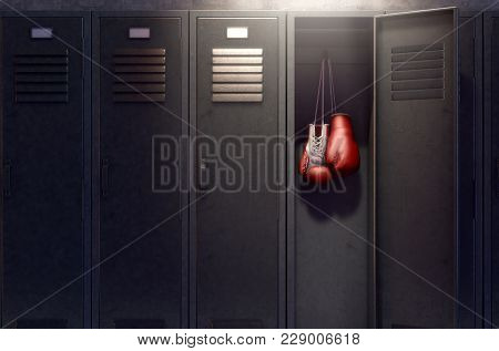 A row of metal gym lockers with one open door revealing that it has a pair of boxing gloves hanging up inside - 3D render stock photo