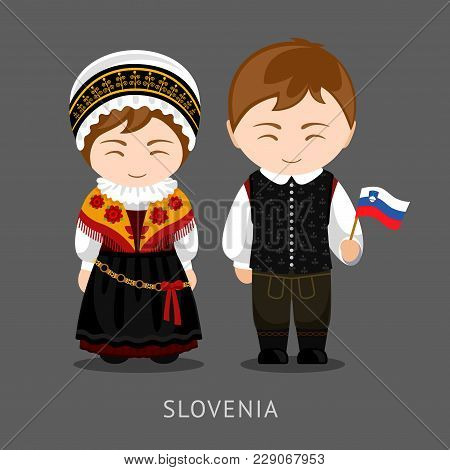Slovenes in national dress with a flag. Man and woman in traditional costume. Travel to Slovenia. People. Vector flat illustration. stock photo