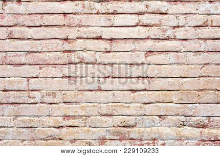 Close-up Textured background of multi-layer flaking paint on the wall. Mixing different colors of paints in the cleaved layers on the surface. Grunge texture with a deep pattern. stock photo
