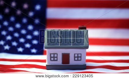 Solar Power Roof concept. Solar Panels on a house with an American flag. Solar Independence in the USA concept. stock photo