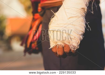 Ancient Muay Thai, Asian man exercising thai boxing,Ancient traditional Muay Thai or Thai boxing fighter putting bandage old style  at Thailand. stock photo
