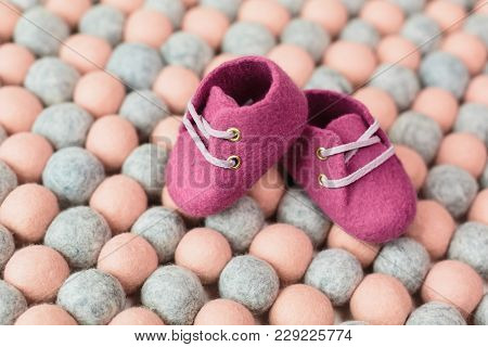 Hand made Merino wool shoes for young children stock photo