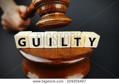 Guilty court decision with judge gavel and wooden cubes with text stock photo
