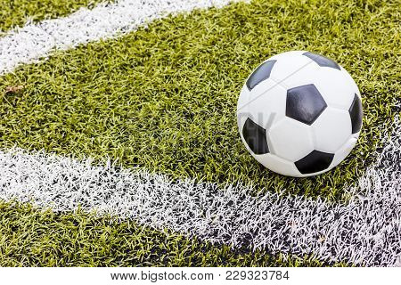 Soccer grass field with marking and ball, Sport stock photo