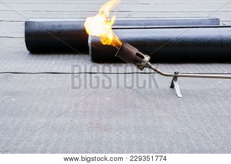 Heating and melting bitumen - roofing felt Flat roof installation. stock photo