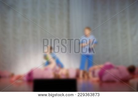 Folk Dances Of Children And Teens Theme Abstract Blur Background With Bokeh Effect. Teens In Bright