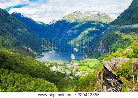 Geirangerfjord and Geiranger village aerial view from Flydalsjuvet viewpoint, Norway stock photo