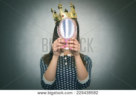 Selfish woman. Arrogant disgruntled girl with high self esteem. Egoist person woman with golden crown on her head. Dissatisfied winner. stock photo