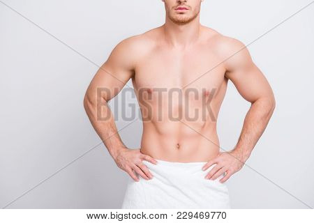 Cropped close up photo of shirtless sexy tempting muscular attractive man's torso, man is keeping hands on hips isolated on gray background copy-spac stock photo