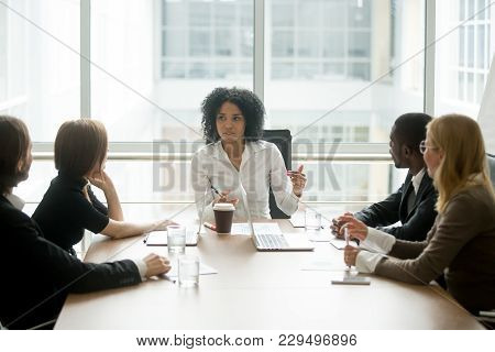 Black Female Boss Leading Corporate Multiracial Team Meeting Talking To Diverse Businesspeople, Afri