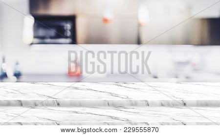 Empty step white marble table top food stand with blur house kitchen background bokeh light,Mock up for product display or montage of design,Banner for advertise on online media stock photo