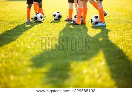 Boys Training Football on the Pitch. Soccer Football Training Session for Kids. Soccer Pitch on a Sunny Day. Football Stadium Grass Background stock photo