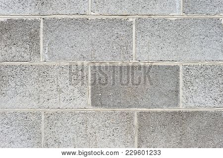 The texture of the wall is the laying of expanded clay blocks. Background for the advertisement of building materials. Close-up Gray concrete foam block stock photo