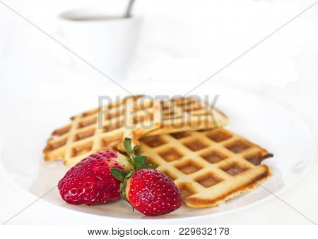 Viennese waffles with berries. Wafers with strawberries and currants. Fresh baked waffles on a white background stock photo