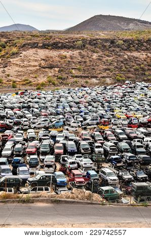 Scrap Yard With Pile Of Crushed Cars in tenerife canary islands spain stock photo