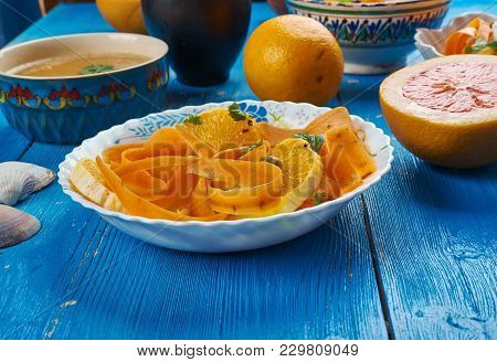 Moroccan cuisine,  Carrot Salad with Oranges and Medjool Dates, Traditional assorted Moroccodishes, Top view. stock photo
