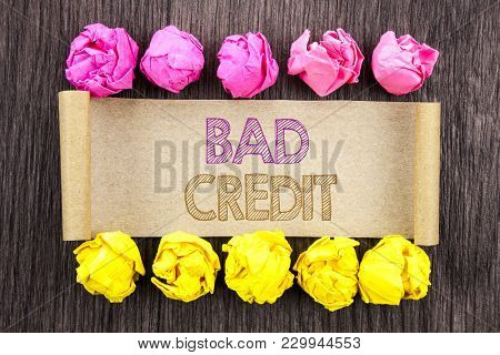 Writing text  Bad Credit. Concept meaning Poor Bank Rating Score For Loan Finance written sticky note paper with folded paper yellow and pink the wooden background. stock photo