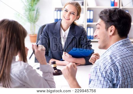 Young family signing marriage documents at laywers office stock photo
