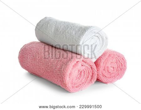 Rolled clean towels on white background. Laundry day stock photo